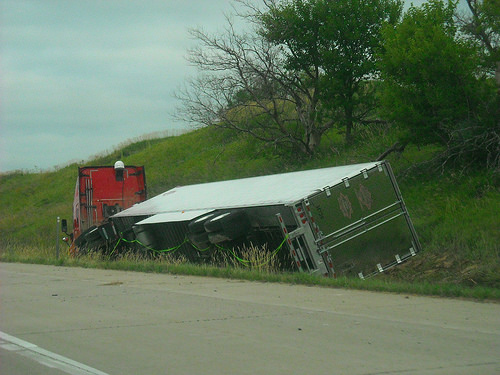 truck accident on the side of a high way